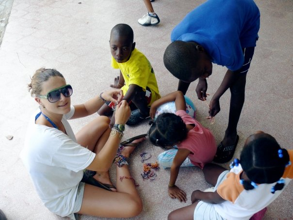 Tying friendship bracelets during my first trip to the Dominican Republic in 2009.